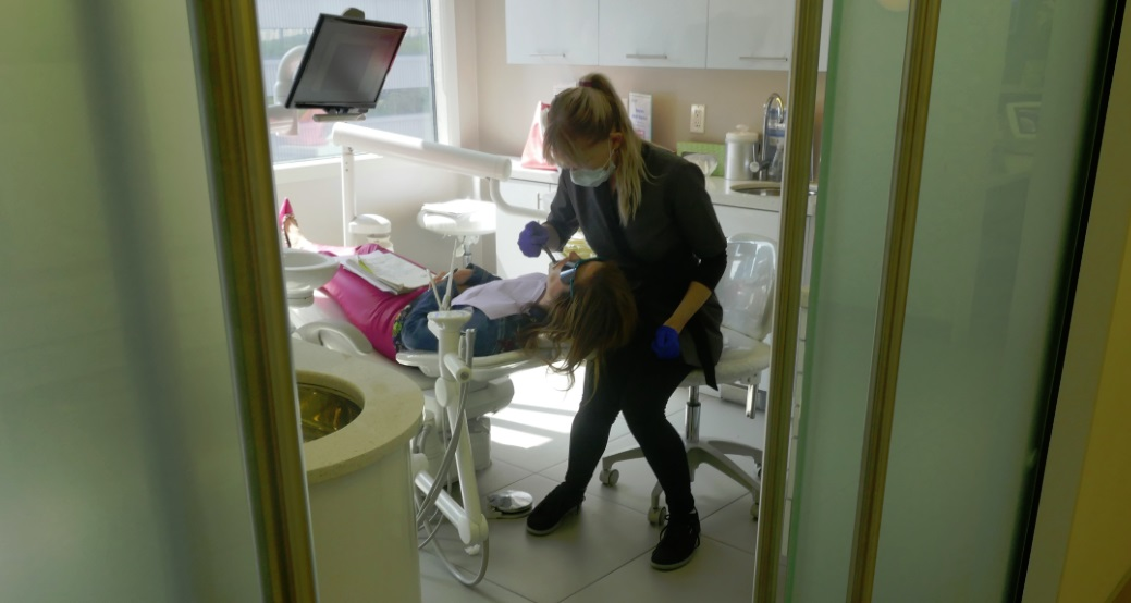 working in the dental operation room